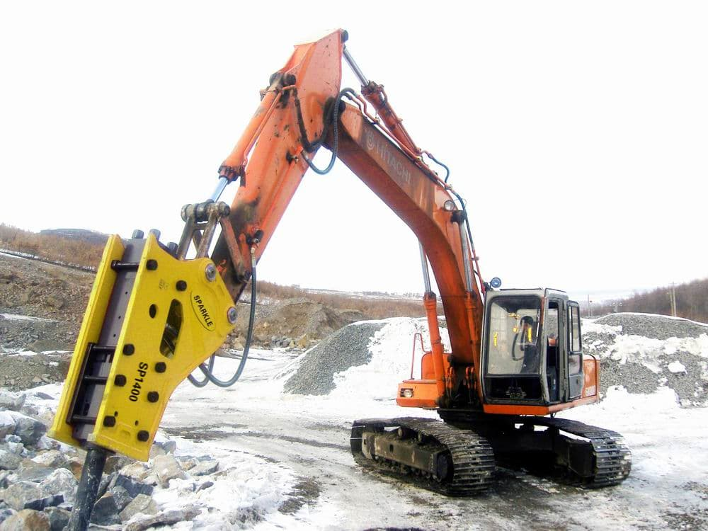 Hydraulic rock breaker with excavator
